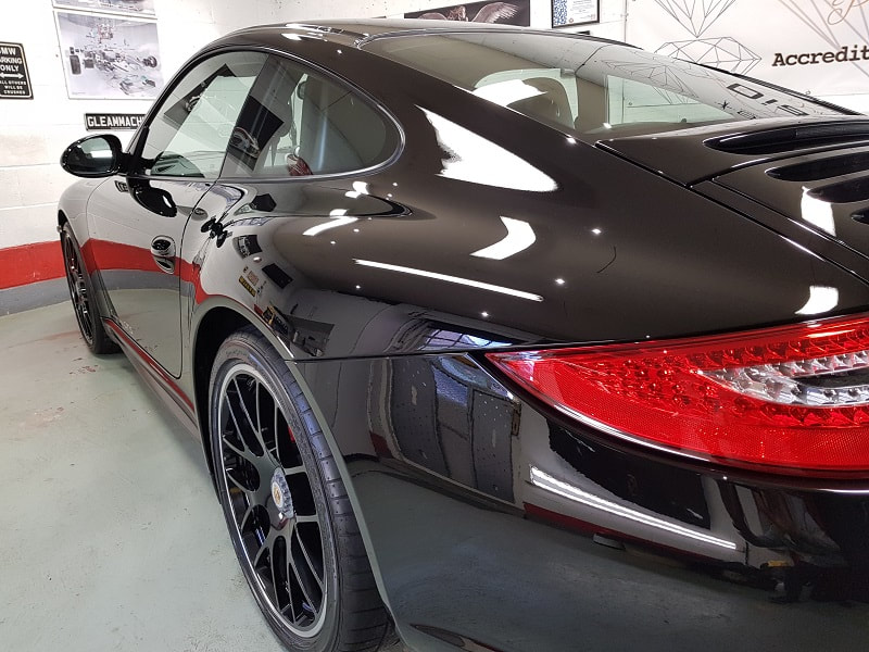 Solid black Porsche 997 GTS professionally detailed