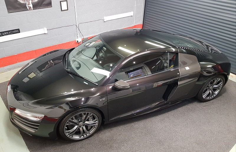 Black Audi R8 parked in a detailing studio