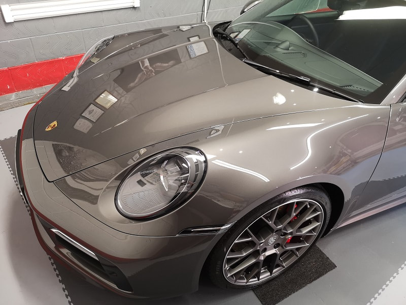 A professionally detailed Porsche 911 with ceramic coating protection.